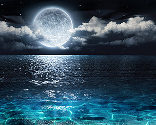 Moon at night over the sea