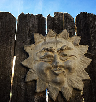 Sun sculpture on steaming fence