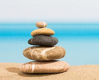 Stack of rocks on sand